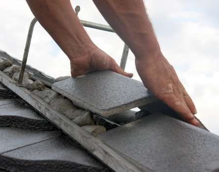 Roof ridges being repaired with Mortar Lite